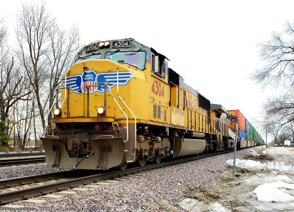 UP 4304 is in charge of a west bound stack train